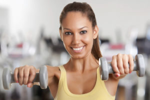Woman working out with dumbbells.